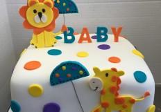 lion and giraffe baby shower cake